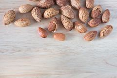 Almond nuts on wooden table Stock Photo