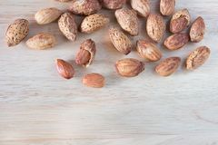 Almond nuts on wooden table Royalty Free Stock Images