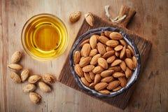 Almond oil and almonds Stock Photos