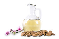 Almond oil and almonds with flowers Royalty Free Stock Photography