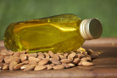 Almond oil in a bottle and almonds nuts Royalty Free Stock Photography