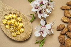 Almond oil in capsules Royalty Free Stock Images
