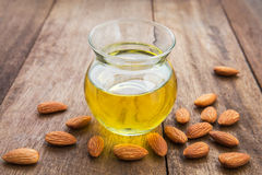 Almond oil in glass bottle and almonds Stock Photography