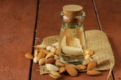 Almond oil in a glass bottle Stock Images