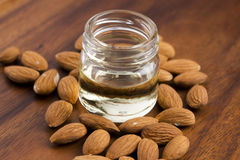 Almond oil with nuts Stock Image