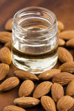 Almond oil with nuts Stock Photo