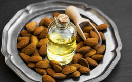 Almond oil in transparent bottle with almonds Royalty Free Stock Photography