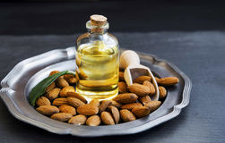 Almond oil in transparent bottle with almonds Royalty Free Stock Image
