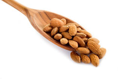 Almond over wood spoon Royalty Free Stock Image