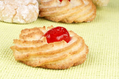 Almond pastry with candied cherry Royalty Free Stock Photography