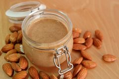 Almond peanut butter in the jar. Homemade almond peanut butter in the jar putting on the bread is delicious stock image