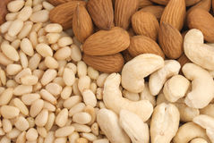 Almond, pine nuts (cedar), cashew close-up. Nuts background. Almond, pine nuts (cedar), cashew close-up Stock Image