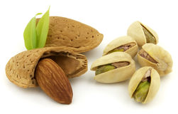 Almond with pistachio. On a white background royalty free stock images