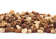 Almond, pistachio, peanut, walnut, hazelnut mixed pile. As a background composition Royalty Free Stock Image