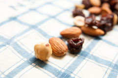 Almond raisins nuts. Almond dried raisins and nuts on a fabric stock photo