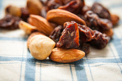 Almond raisins nuts. Almond raisins and nuts pile on a fabric royalty free stock photography