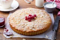 Almond and raspberry cake, Bakewell tart. Traditional British pastry. Wooden background. Close up. Almond and raspberry cake, Bakewell tart. Traditional British royalty free stock image