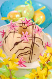 Almond ring cake for easter. Almond ring cake poured white and dark chocolate on easter table Stock Photography