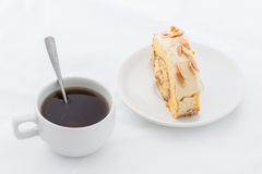 Almond roll cake on white dish with hot drink Stock Photo