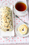 Almond roulade. With cottage cheese and cherry filling Stock Photos