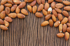 Almond seed on wooden background Stock Photo