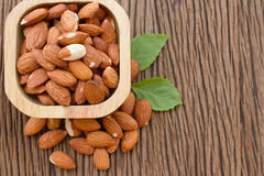 Almond seed on wooden bowl Stock Photo
