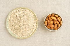 Almond seeds and almond flour Stock Photography