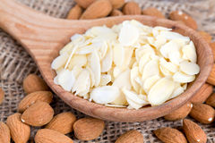 Almond slices in  a wooden spoon Stock Photography