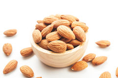 Almond snack fruit in wooden bowl Stock Images