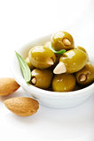 Almond stuffed green olives isolated on white Stock Photo