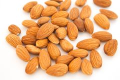 Almond superfood  on white background. Concept of healthy life. Close up. Nuts fill the whole frame royalty free stock photos