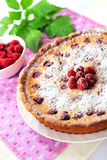 Almond tart with raspberries stock photography