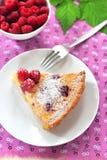 Almond tart with raspberries royalty free stock photo