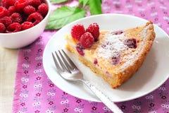 Almond tart with raspberries stock photos