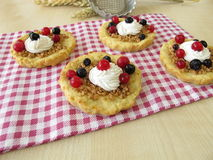 Almond tartlet with cake cream and berries Royalty Free Stock Photos