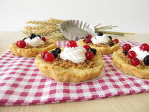 Almond tartlet with cake cream and berries Royalty Free Stock Photography