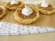 Almond tartlets withe cake cream Royalty Free Stock Photos