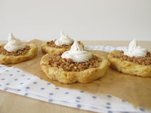 Almond tartlets withe cake cream Royalty Free Stock Photography