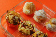 Almond tarts and mini cream puffs. In glass dish stock photography