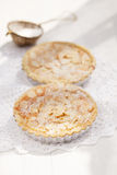 Almond tarts on wooden white table Stock Images