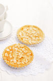 Almond tarts on wooden white table Royalty Free Stock Photography