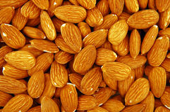Almond texture. Pile of almonds close-up royalty free stock image