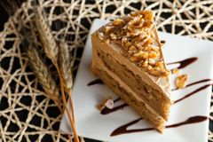 Almond Toffee Cake. Slice of almond toffee cake with coffee flavored icing Royalty Free Stock Image