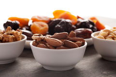 Almond, walnut and peanuts with dried fruits Stock Photos