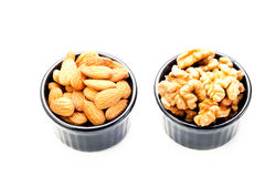 Almond and walnut in ramekins Stock Image