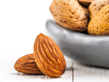 Almond on white wooden background stock images