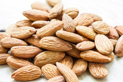 Almond on wooden background Royalty Free Stock Photo