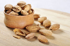 Almond in a wooden bowl Stock Photos
