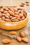 Almond in wooden bowl Stock Photo