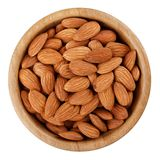 Almond in wooden bowl isolated on white background royalty free stock photography